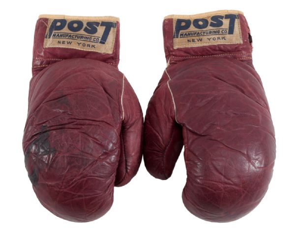 CASSIUS CLAY AUTOGRAPHED AND DATED 1960 POST TRAINING WORN GLOVES