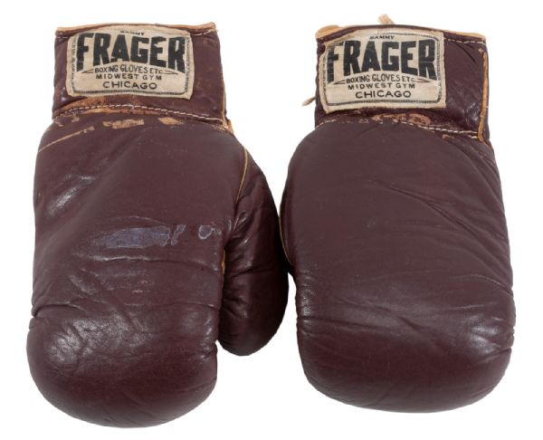 CASSIUS CLAYS FIGHT-WORN GLOVES FROM HIS HISTORIC FEBRUARY 25, 1964 BOUT VS. SONNY LISTON