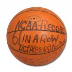 UCLA TEAM SIGNED GAME BALL FROM NCAA RECORD 61ST CONSECUTIVE WIN GAME PLAYED ON JANUARY 27, 1973 VS. NOTRE DAME (HELMS/LA84 COLLECTION)