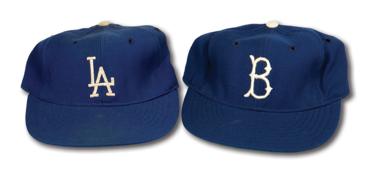 WALTER ALSTONS C.1955 BROOKLYN DODGERS AND C.1959 LOS ANGELES DODGERS PAIR OF WORLD CHAMPIONSHIP SEASON GAME WORN CAPS (ALSTON COLLECTION)