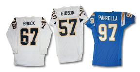 SAN DIEGO CHARGERS 1994-1999 GAME READY GROUP OF JOHN PARRELLA THROWBACK UNIFORM, DENNIS GIBSON ROAD JERSEY, STAN BROCK COLD WEATHER JERSEY & ROMAN FORTIN PANTS (SDHOC COLLECTION)