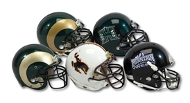 MOUNTAIN WEST LOT OF (4) GAME USED HELMETS INCL. WYOMING COWBOYS, HAWAII RAINBOW WARRIORS (#86), AND (2) COLORADO STATE RAMS (SDHOC COLLECTION)