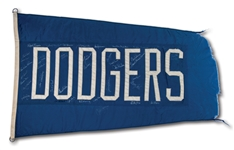 C.1970S DODGERS (3 X 5 FT.) TEAM FLAG SIGNED BY 40 FORMER DODGERS GREATS INCL. KOUFAX, SNIDER, REESE, ETC. (FLOWN AT WRIGLEY FIELD)