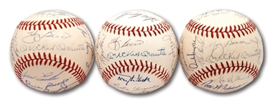 1962 (WS CHAMPS), 1963 AND 1964 (AL CHAMPS) NEW YORK YANKEES TEAM SIGNED OAL (CRONIN) BASEBALLS TRIO - EACH WITH PSA/DNA LOAS