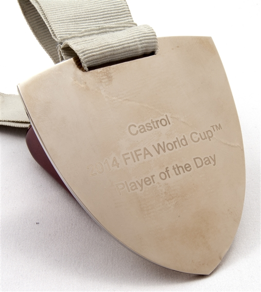 2014 FIFA WORLD CUP PLAYER OF THE MATCH MEDAL PRESENTED TO BRAZIL PLAYER (BRAZIL KITMAN PROVENANCE)