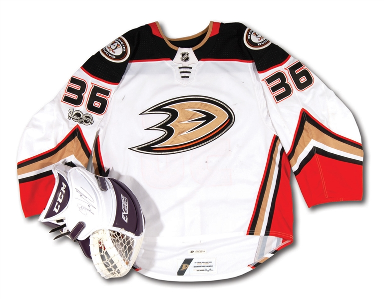 2017-18 JOHN GIBSON ANAHEIM DUCKS GAME WORN HOME JERSEY AND GAME USED & SIGNED GOALIE GLOVE (DUCKS TEAM LOA)
