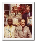 1974 BASEBALL HALL OF FAME INDUCTION CLASS MULTI-SIGNED PHOTOGRAPH WITH MANTLE, FORD, BELL AND CONLAN