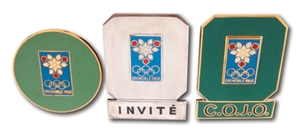 LOT OF (3) 1968 GRENOBLE WINTER OLYMPICS BADGES: GUEST (SILVER CHROME), ORGANIZING COMMITTEE, AND PUBLIC SERVICE