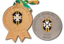PAIR OF 1994 BRAZIL FOOTBALL CONFEDERATION (CBF) FIFA WORLD CUP CHAMPIONS COMMEMORATIVE MEDALS (TECHNICAL COORDINATOR LOAS)