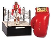 MUHAMMAD ALI SIGNED EVERLAST GLOVE WITH 1976 MEGO ACTION FIGURE DISPLAYED IN MINI RING SOURCED FROM NEVADA BOXING HALL OF FAME