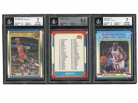 1986 FLEER #132 CHECKLIST WITH MICHAEL JORDAN (BGS NM-MT+ 8.5) PLUS 1988 FLEER #120 JORDAN ALL-STAR AND FLEER STICKER #7 MJ (BOTH BGS NM 7) - GALLAGHER COLLECTION