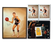 JERRY WEST SIGNED 23 X 30 FRAMED ROOKIE CANVAS AND (2) SIGNED 11 X 14 ROOKIE PHOTOS PLUS MAGIC JOHNSON & WEST DUAL-SIGNED 16 X 20 MAGIC JERSEY RETIREMENT PHOTO